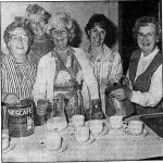 Ladies getting on with the serious business of making tea and coffee