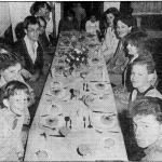 and younger members of the church ready to tuck into their fruit cocktails